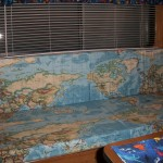 The cushions were made to display the world map fabric continuously across four cushions - two seats and two backs