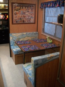 Cushions featuring the world map fabric put the finishing touch on Mr. Wagoner's creation museum.
