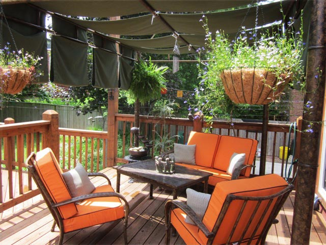 Deep seating chair cushions with throw pillows on the porch.