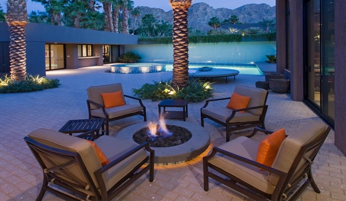 Deep seating chair cushions with throw pillows on the patio.